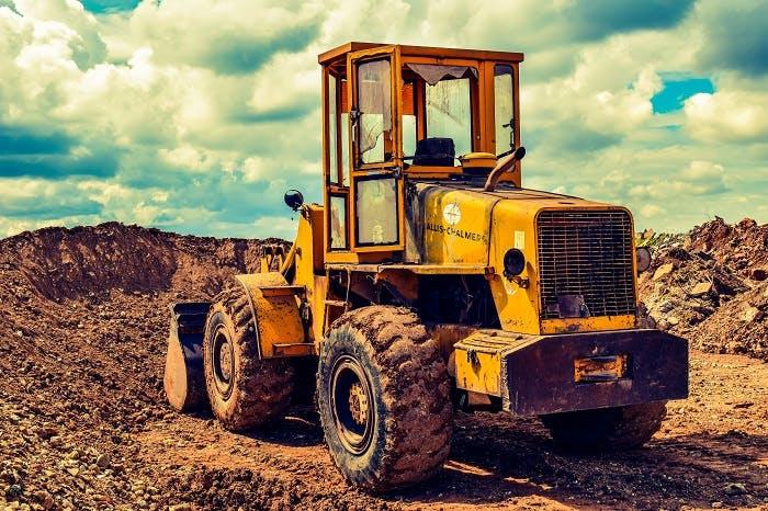bull dozer at a landfill or construction site