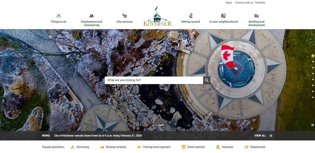 Screen capture of the homepage of kitchener.ca, featuring an aerial view of the Victoria Park clock tower as the background image.