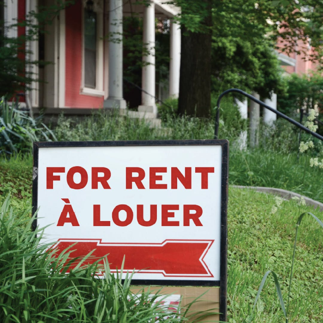 "A ""For Rent"" Sign on a lawn."