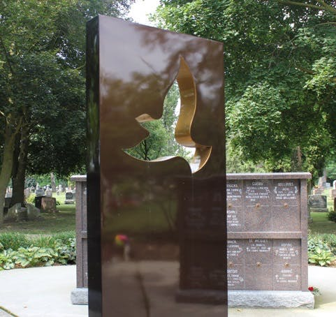 The Serenity Memorial by Ken Hall is located in Greenwood Cemetery in Georgetown.