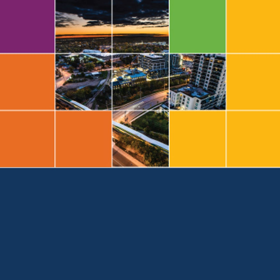 A sunset city-scape in a grid, interspersed with colourful blocks.