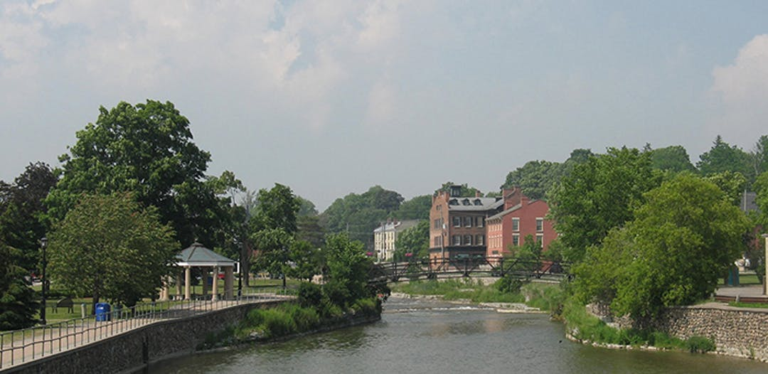 Image of the Ganaraska River in downtown Port Hope with building in background