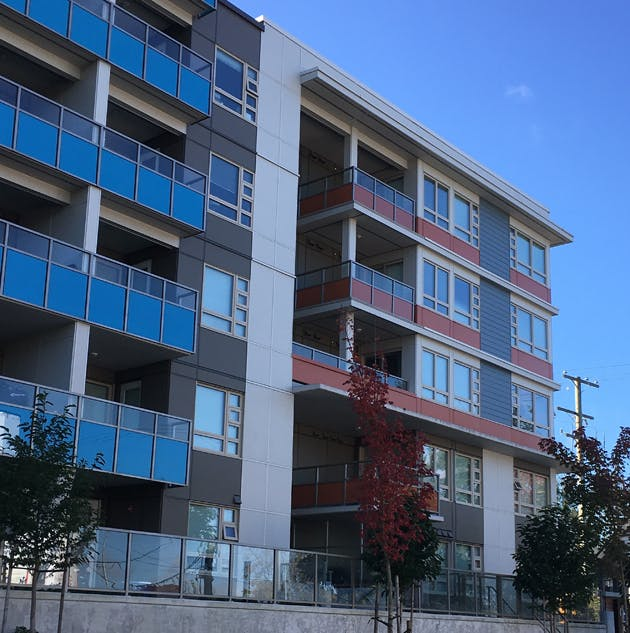 A modern, three-storey rental apartment building in Richmond.