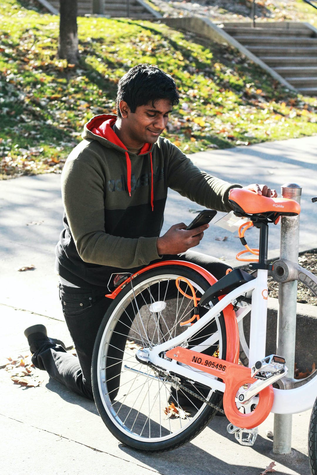 Cyclist using smartphone to unlock bike