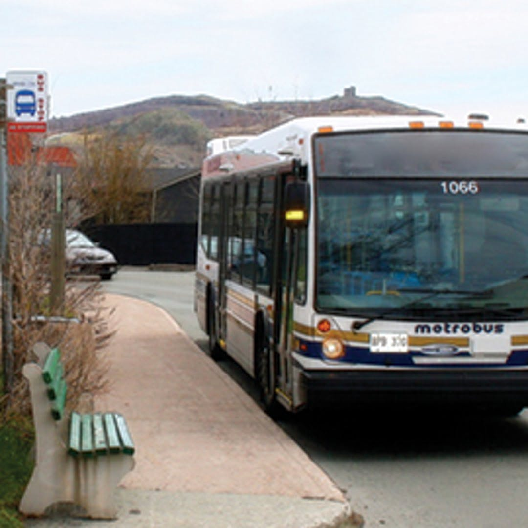 image of a Metrobus, bus stop and bench