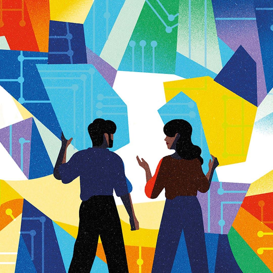 Un homme et une femme se tiennent devant un grand casse-tête coloré, des pièces à la main.
