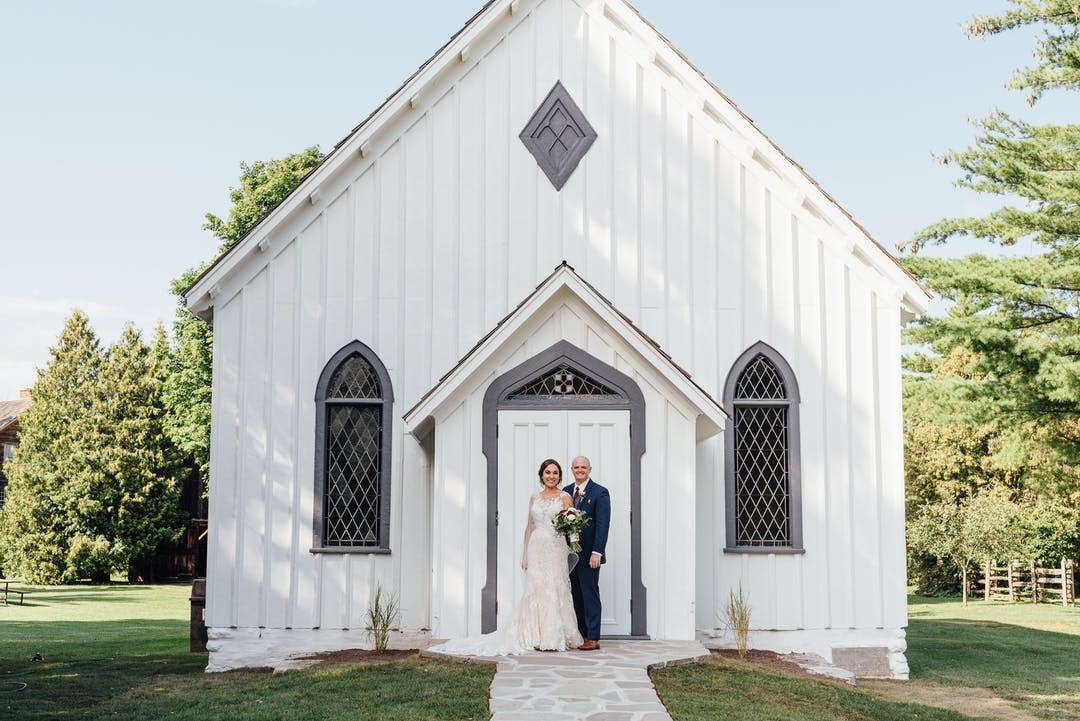Photo of couple in front of Historical Chapel. Photo taken by Green Autumn Photography